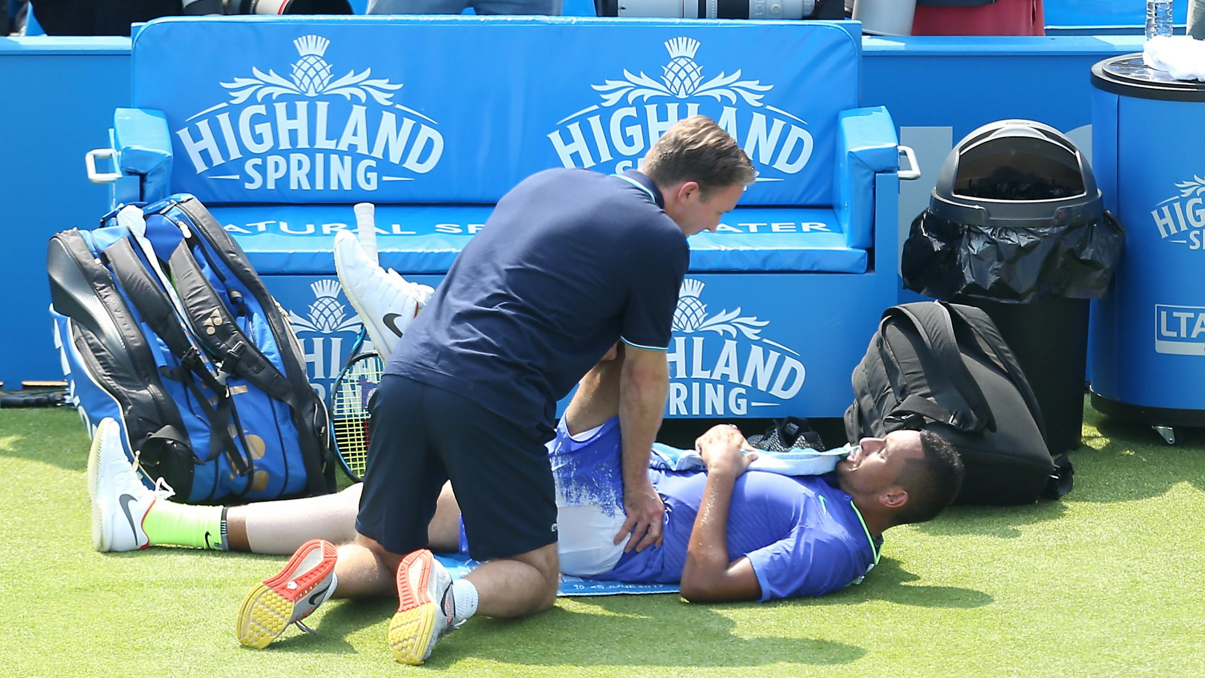 Injured Nick Kyrgios limps out of Queen's